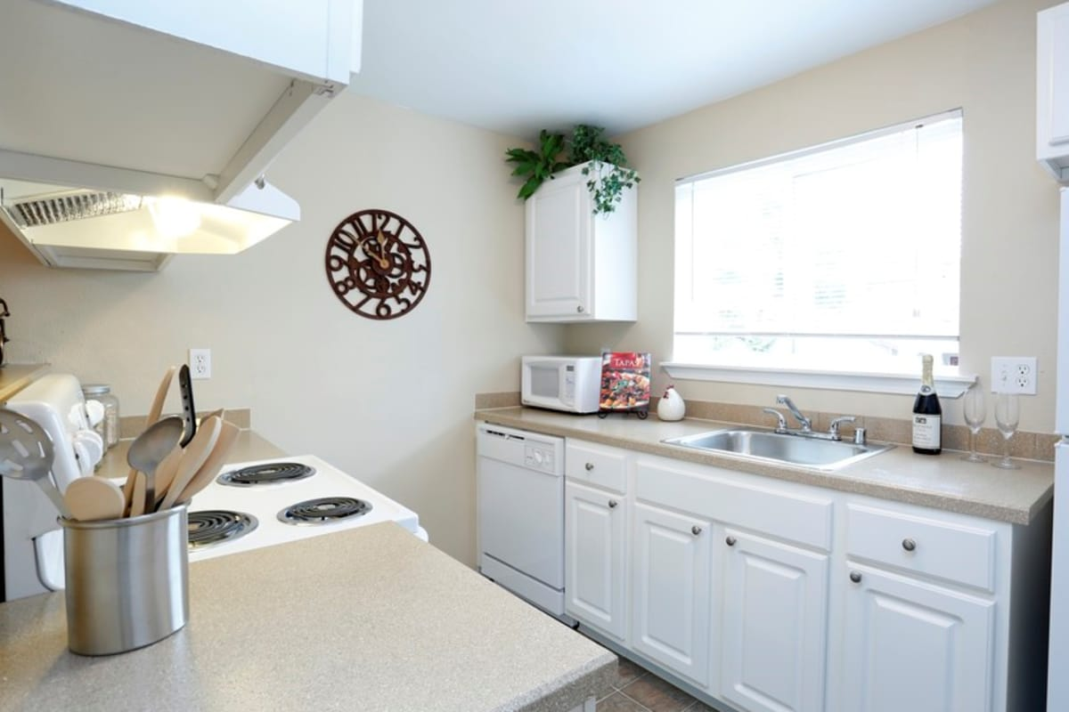 Clean and functional kitchen at Discovery Landing Apartment Homes in Burien, WA