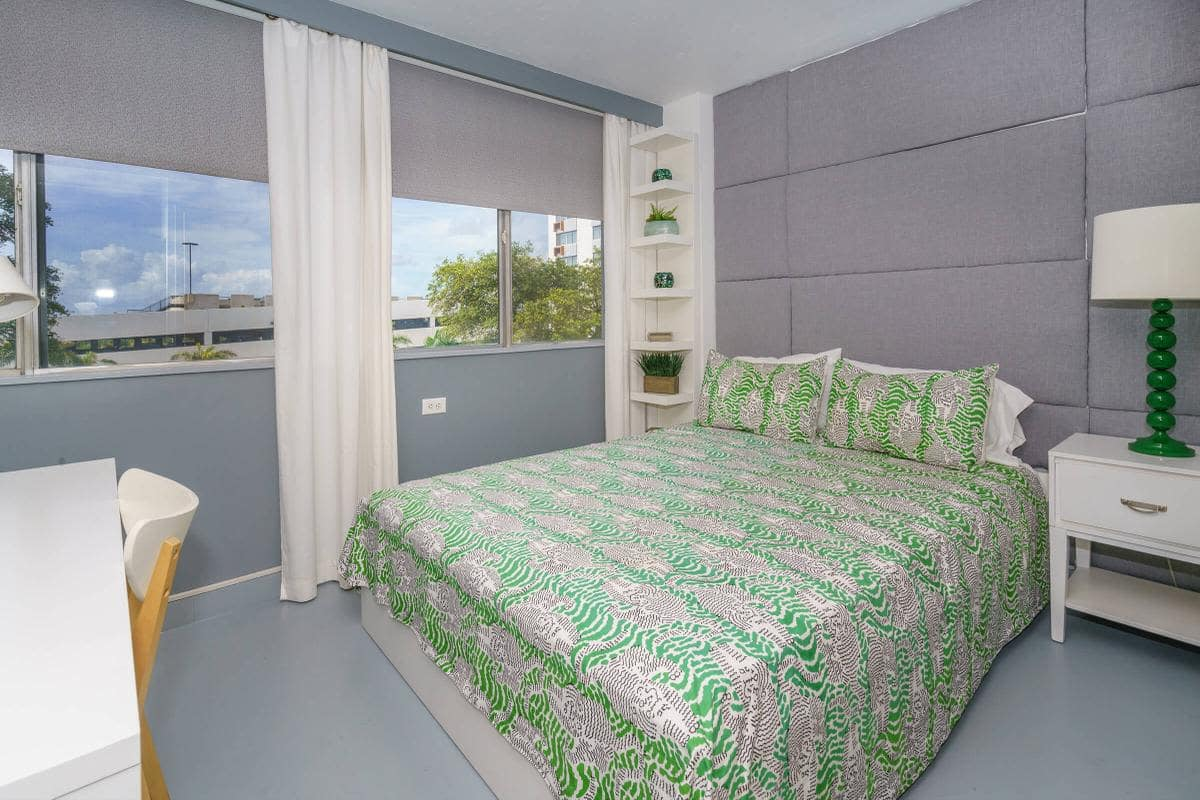 Urban Flats model bedroom with green bedsheets