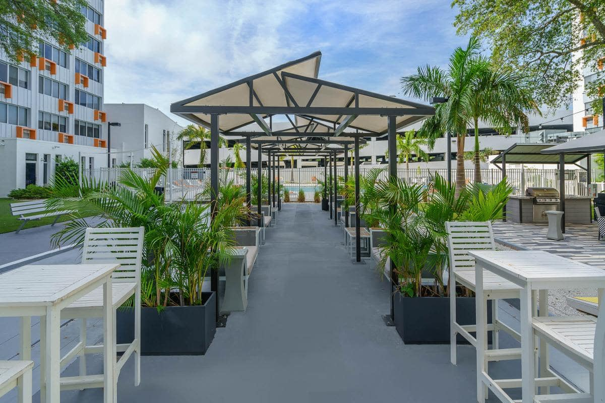 covered walkway with plantlife and seating at Urban Flats