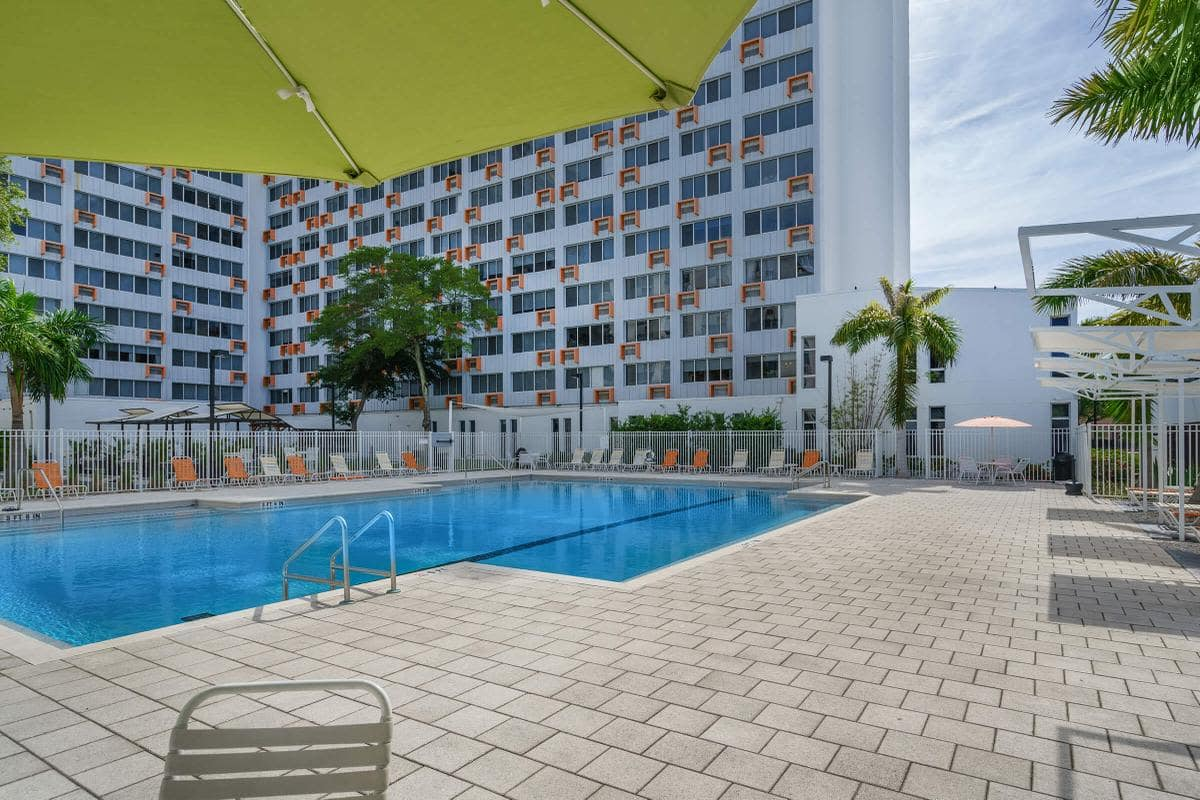luxury pool at Urban Flats with lounge chairs
