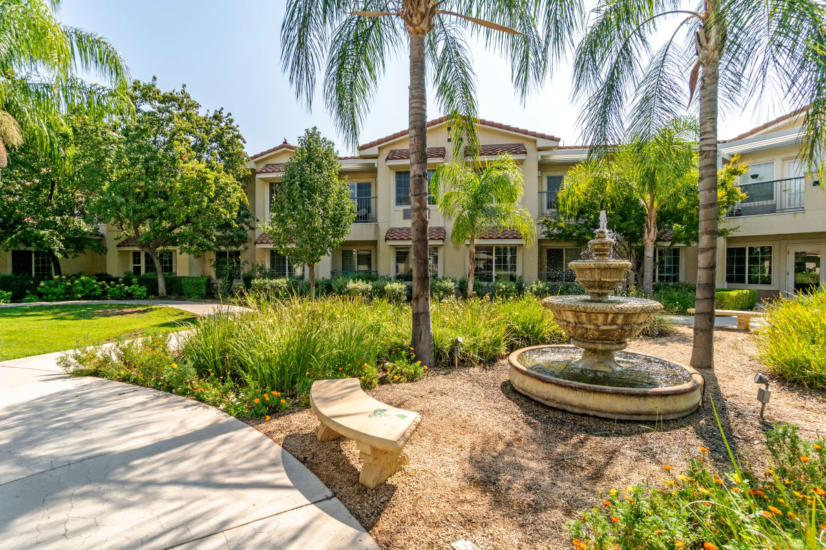 Spacious patio with a beautiful water fountain at Cottonwood Court in Fresno, California
