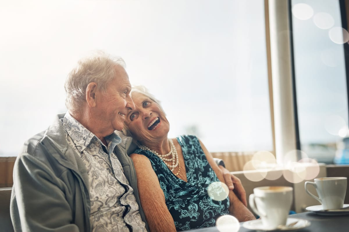 Senior couple laughing together at Sandpiper Courtyard in Mt. Pleasant, South Carolina