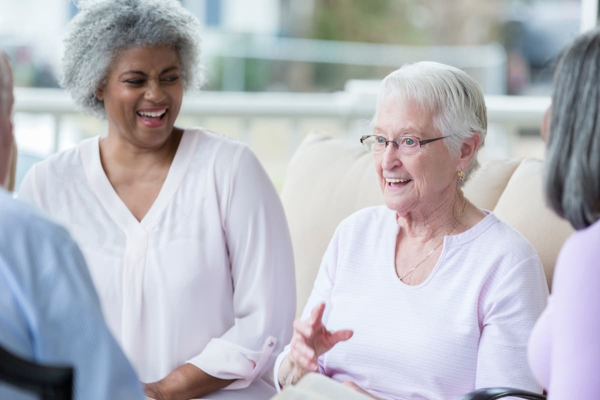 Residents having a casual discussion at Sandpiper Courtyard in Mt. Pleasant, South Carolina