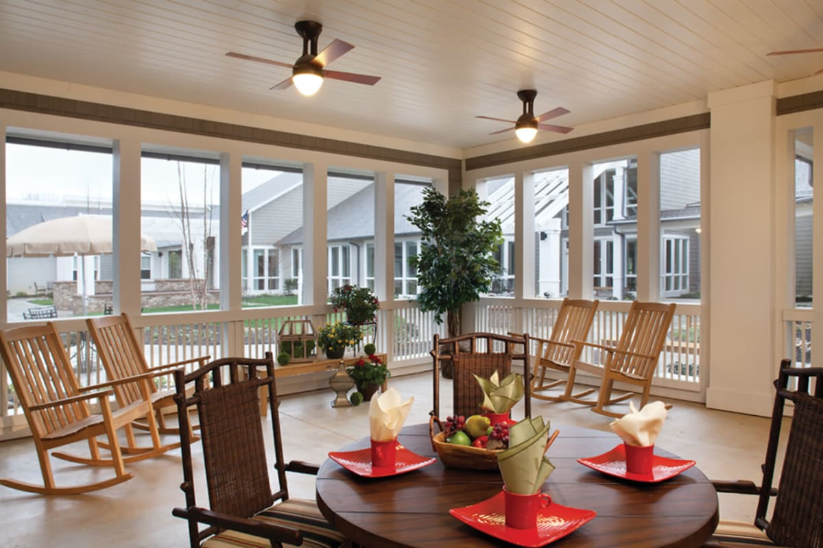 Covered porch and dining area at Avenir Memory Care at Fayetteville in Fayetteville, Arkansas.