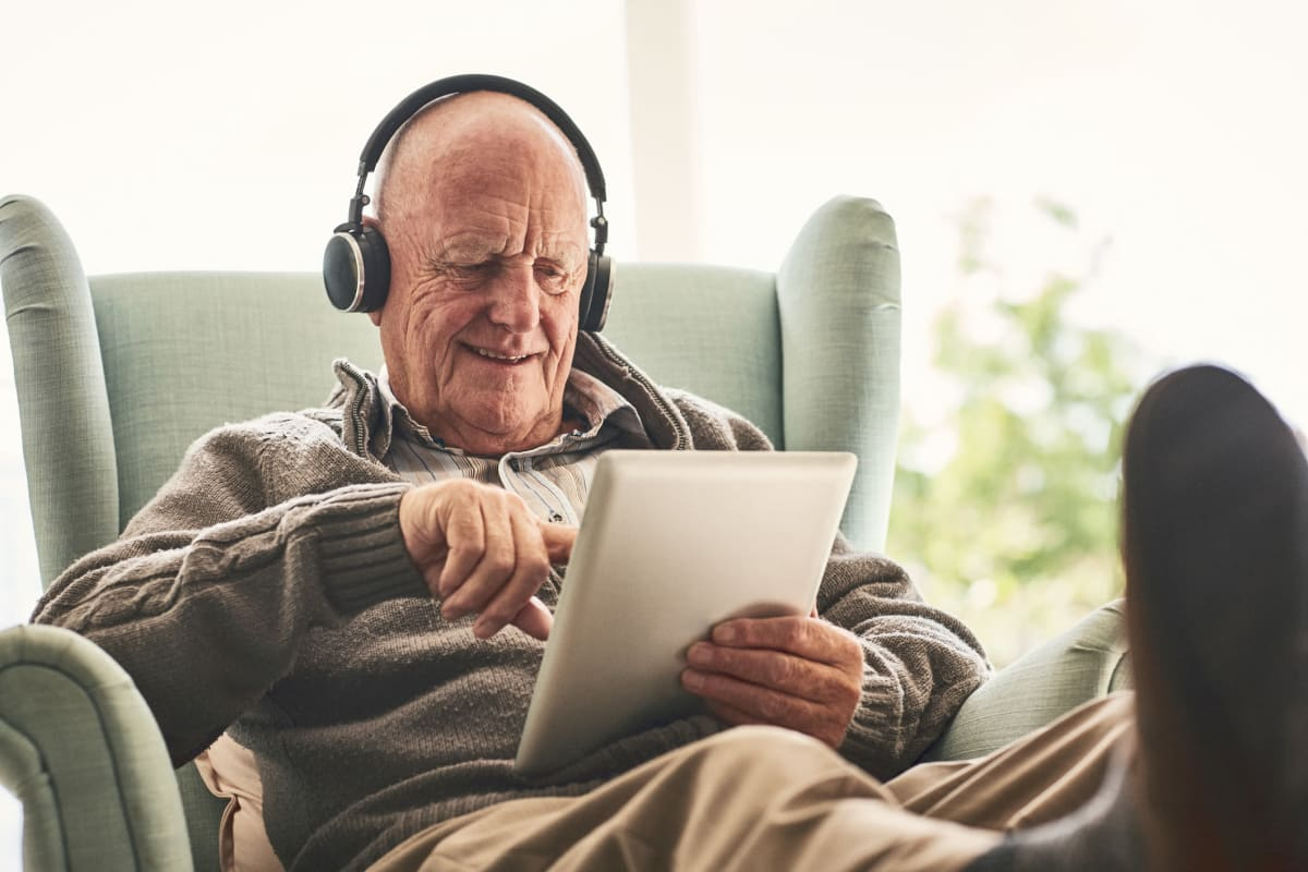 Resident listening to music with headphones at Weatherly Court in Medford, Oregon