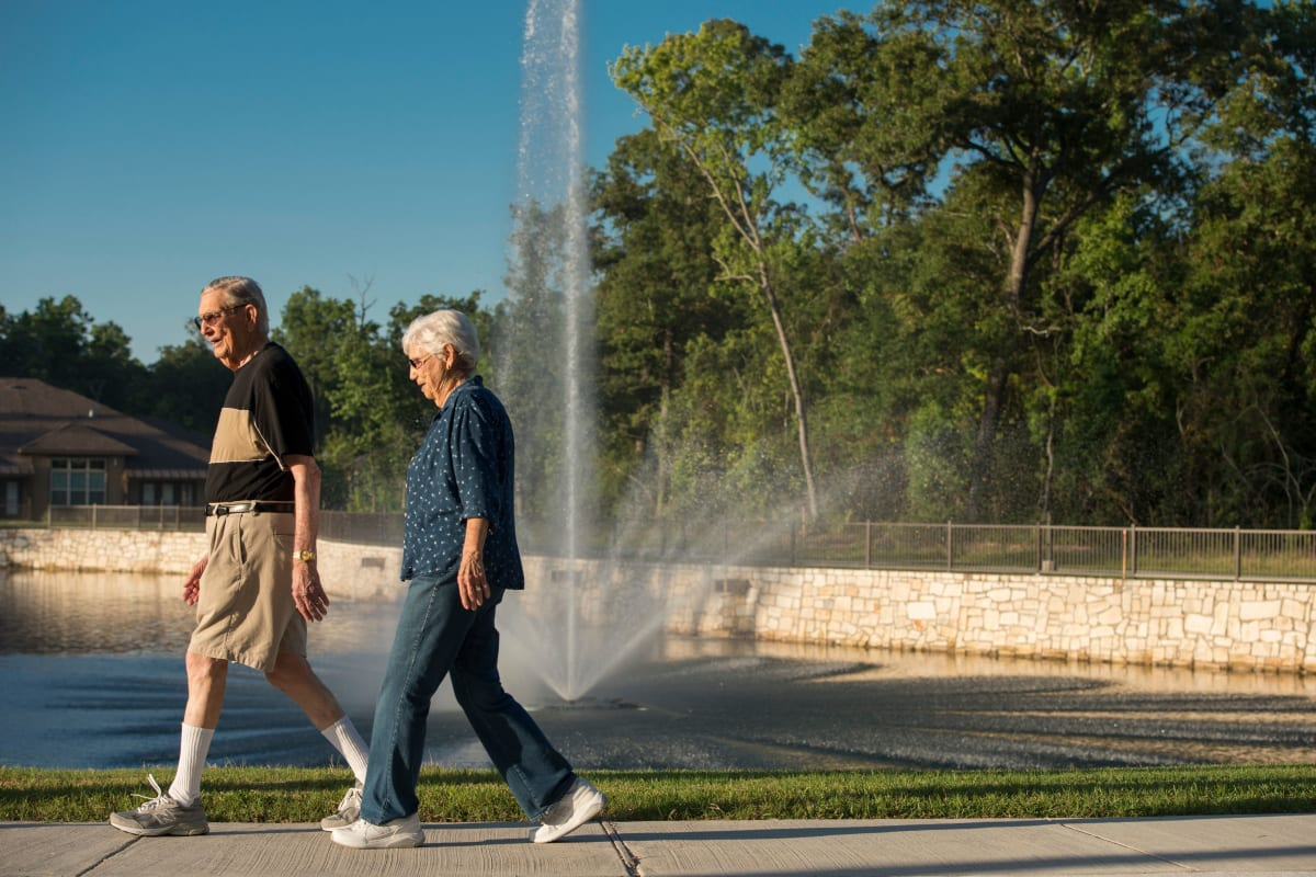 Couple going for a walk at Watermere at Woodland Lakes in Conroe, Texas