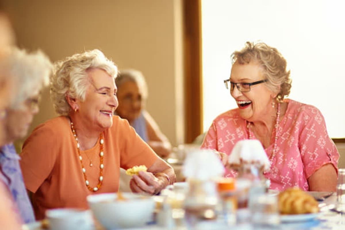 Residents enjoying dining services at The Village at Valley Creek in Denton, Texas
