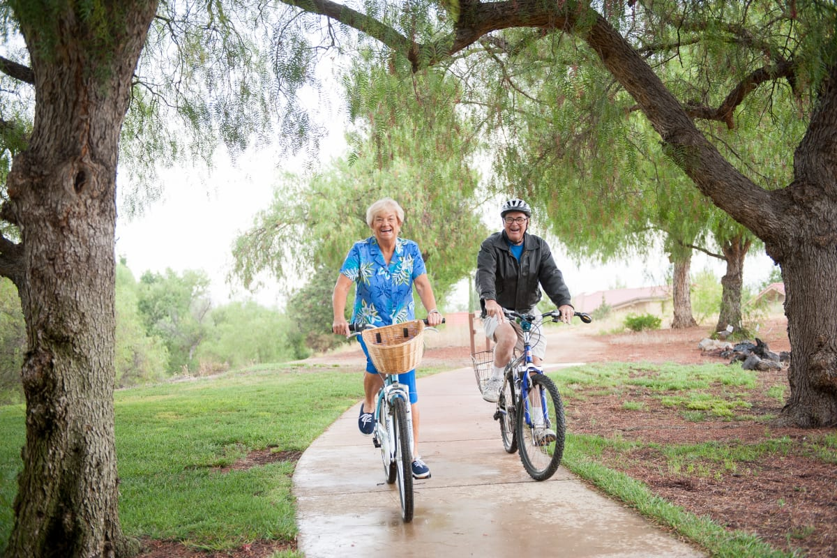 Couple riding bikes in Riverside, California near Westmont Village