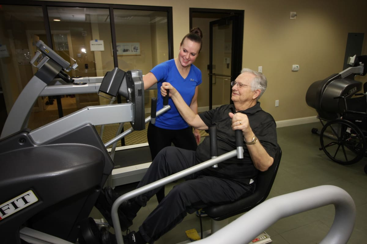 Resident enjoying a personal training session at Prestonwood Court in Plano, Texas