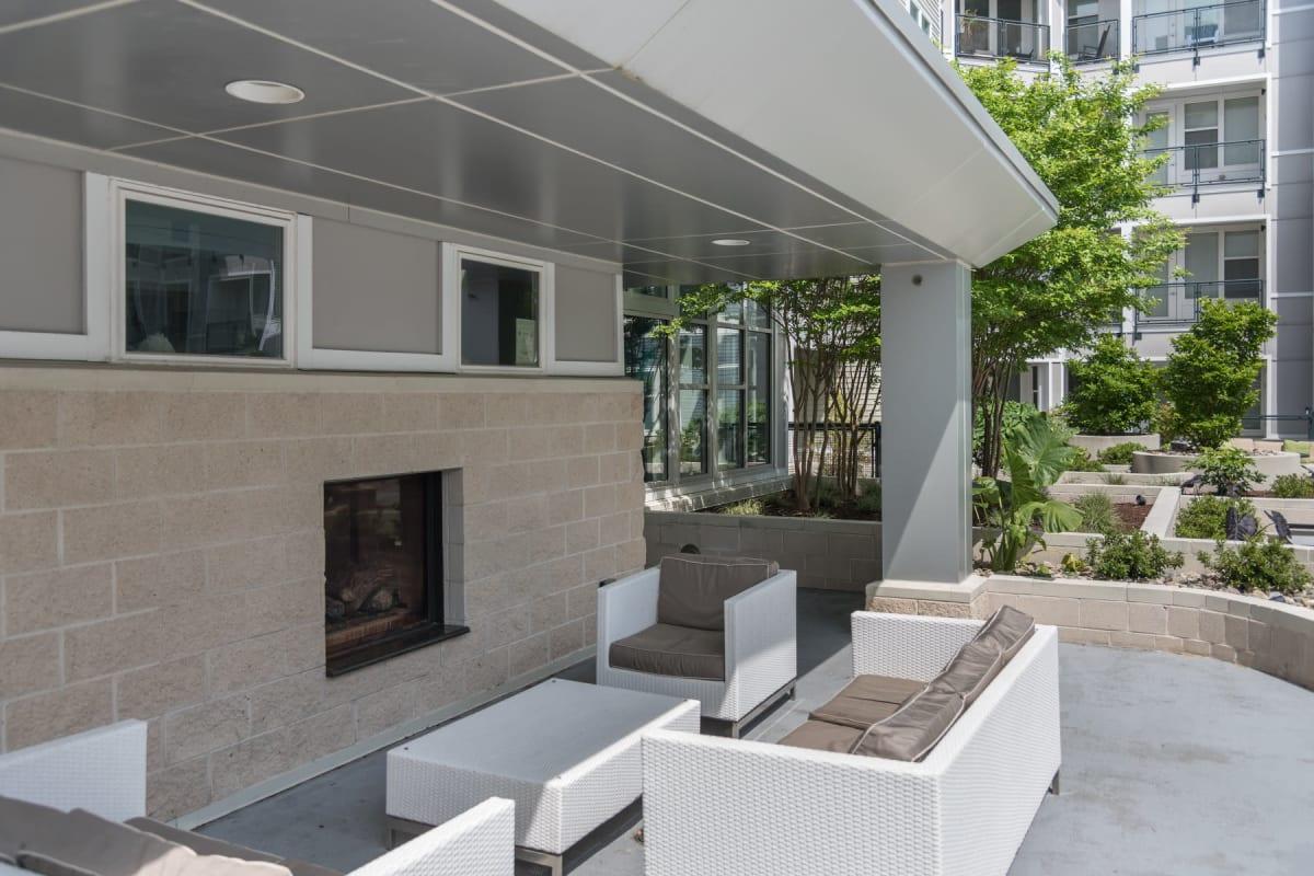 Outdoor lounge with a fireplace at Indigo 19 in Virginia Beach, Virginia
