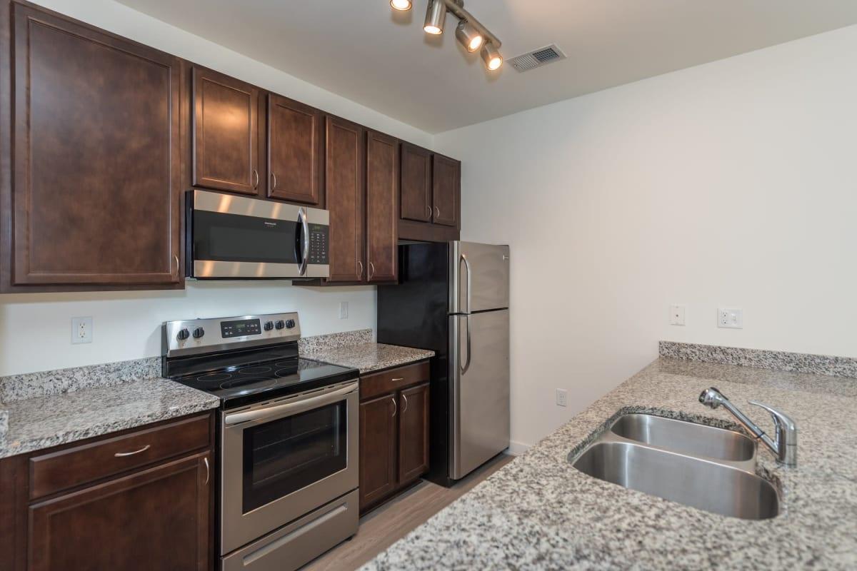 Kitchen with stainless steel appliances at Indigo 19 in Virginia Beach, Virginia
