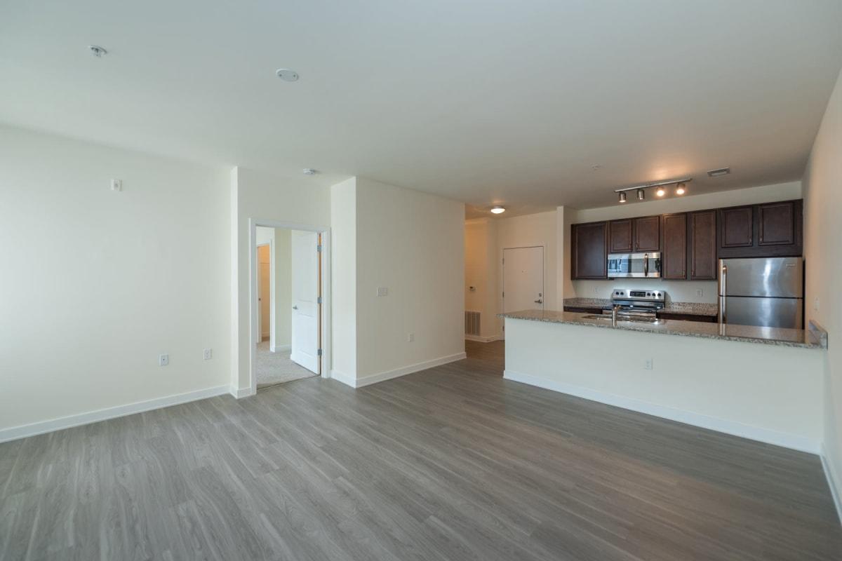 Living room with wood-style flooring at Indigo 19 in Virginia Beach, Virginia