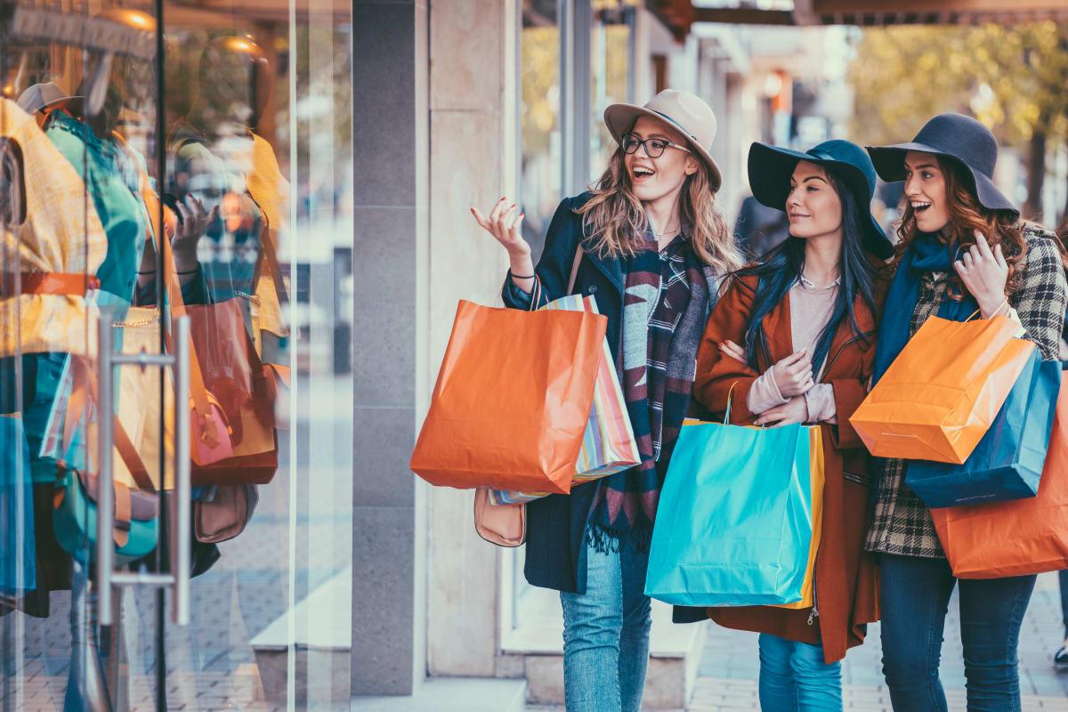 Women on a shopping spree near Brighton Place in Midvale, Utah