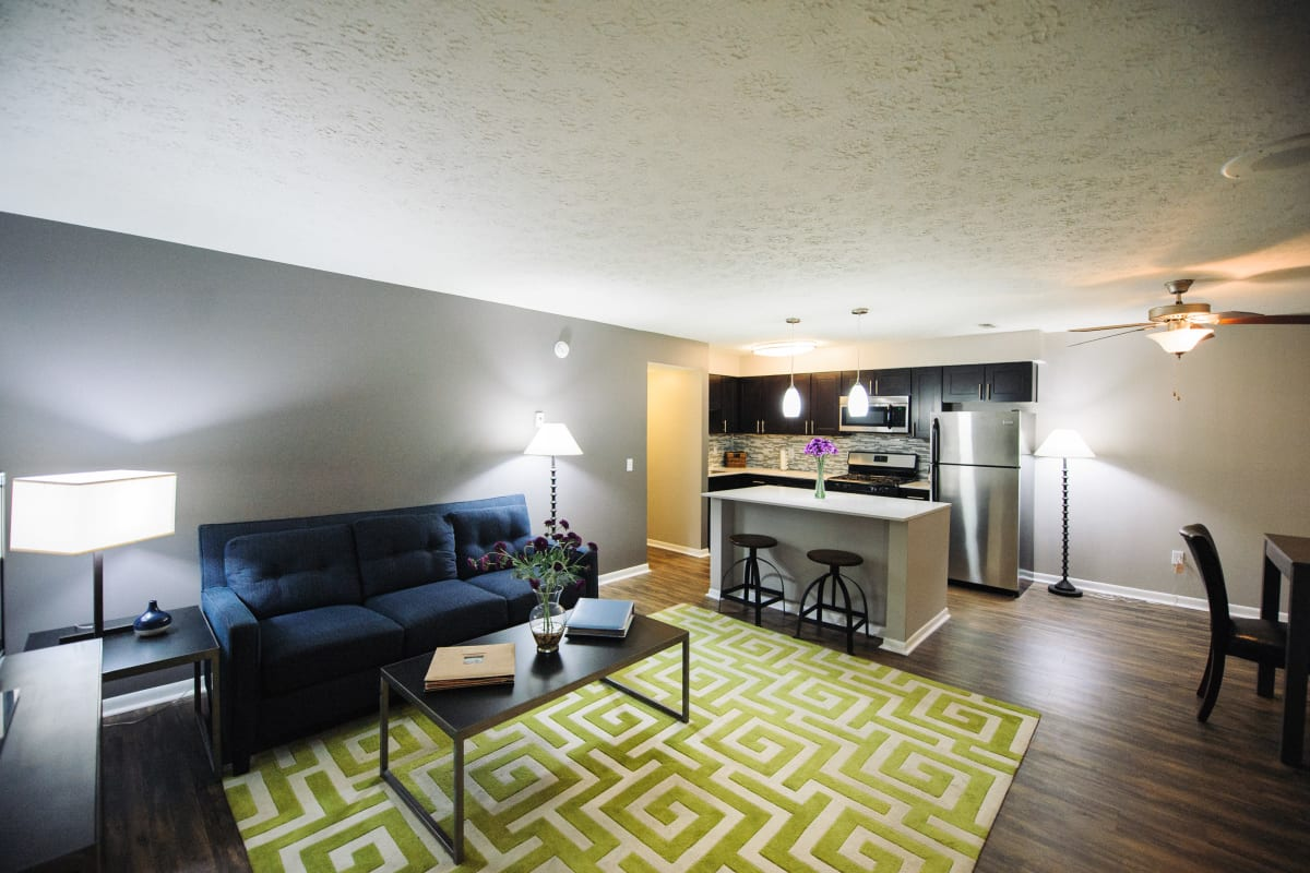 Spacious living room and kitchen at Fox and Hounds Apartments in Columbus, Ohio