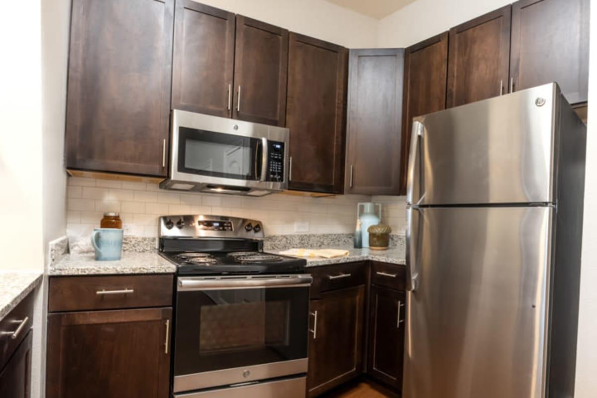 Modern kitchen amenities at Artistry at Craig Ranch in McKinney, Texas