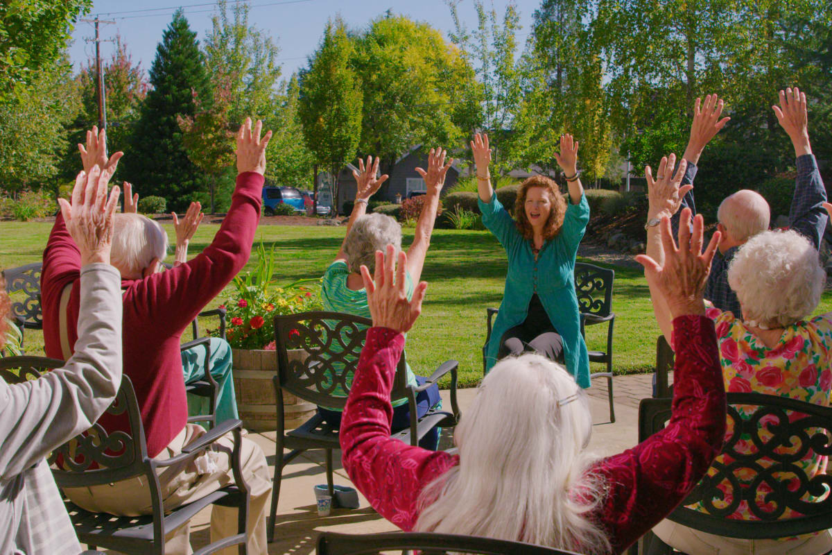 Residents engaging in group exercise at Pioneer Village in Jacksonville, Oregon