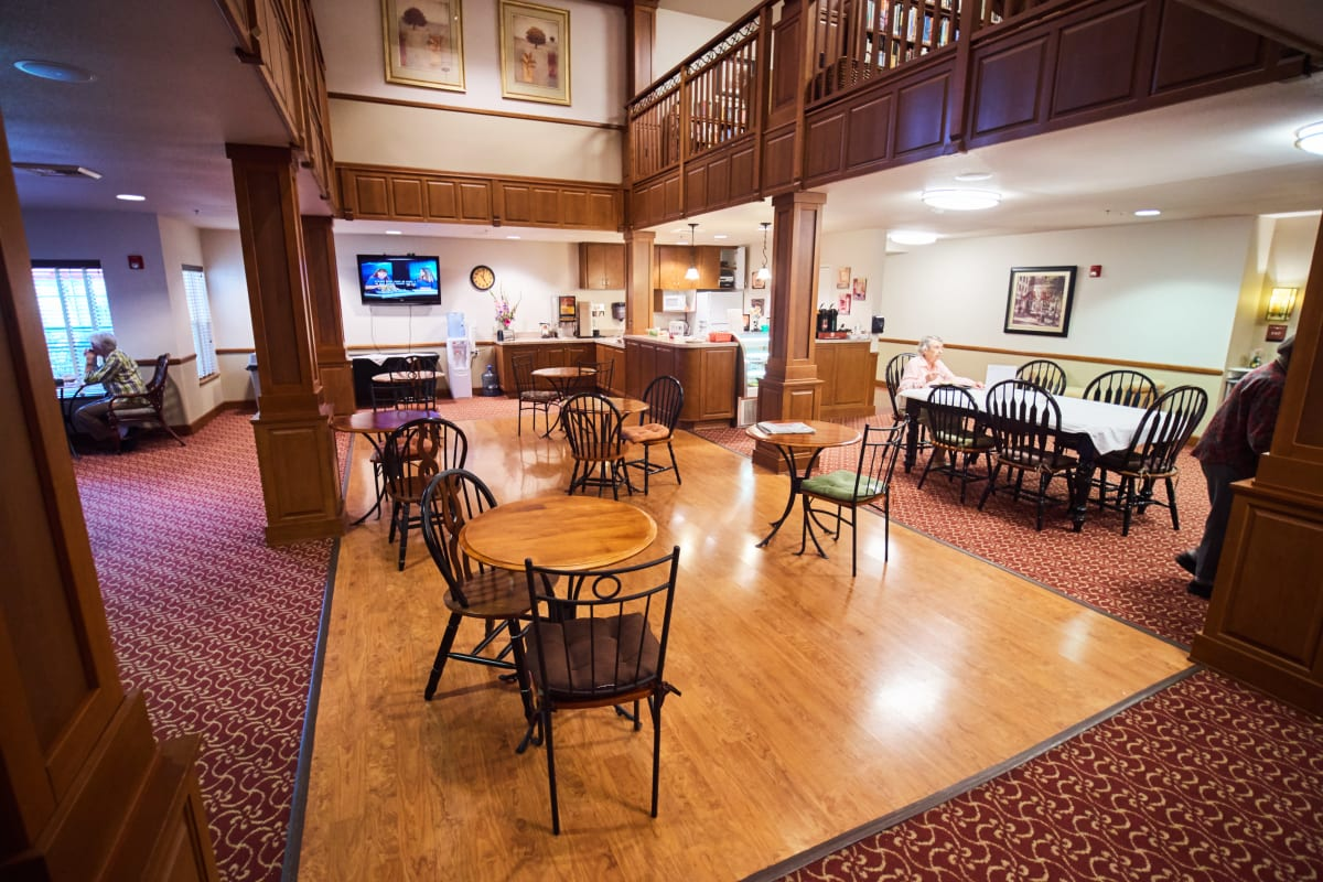Senior apartment living room with a in-room dining menu at Pioneer Village in Jacksonville, Oregon