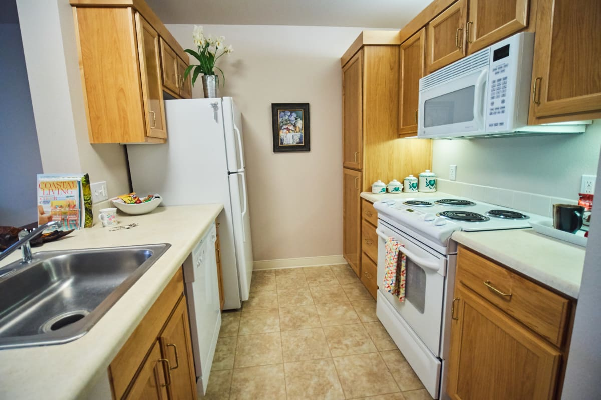 Hallway-style kitchen in an apartment at Pioneer Village in Jacksonville, Oregon