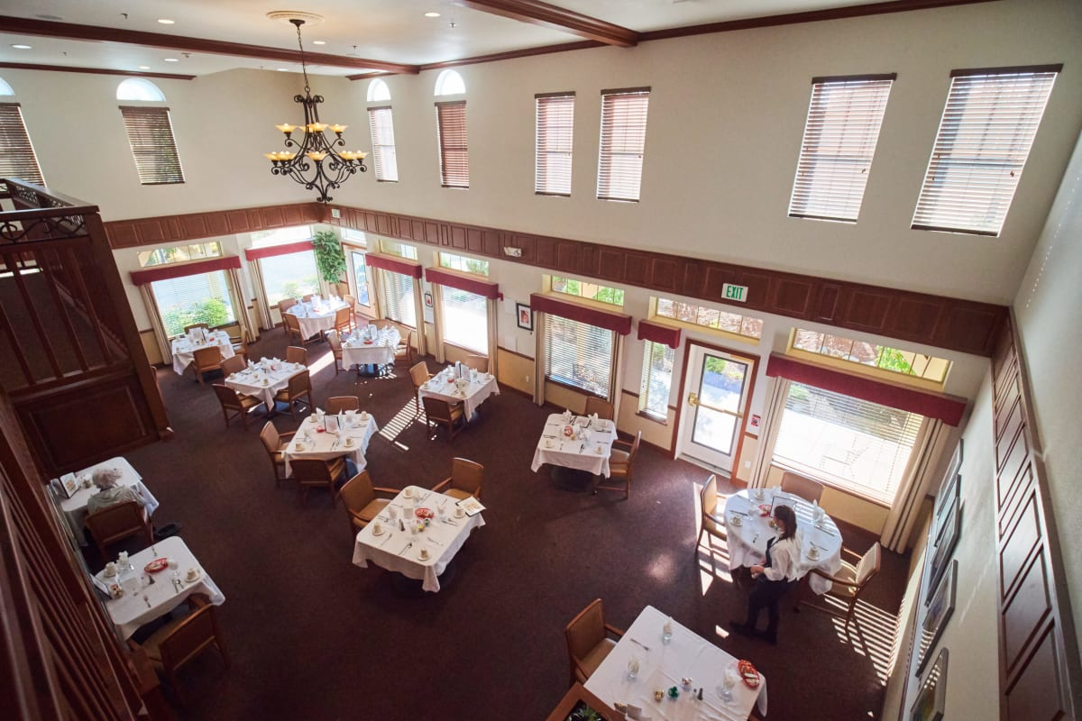 Dining hall with High ceilings and ample space at Pioneer Village in Jacksonville, Oregon