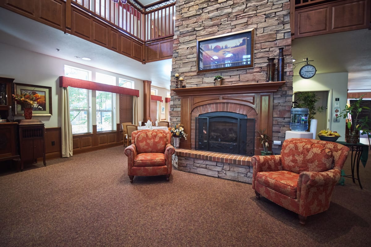 Fireplace lounge with a tv and seating at Pioneer Village in Jacksonville, Oregon
