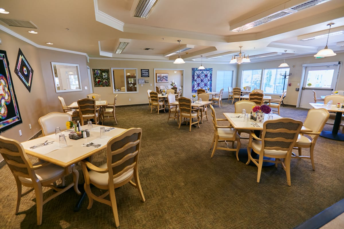 Secondary dining hall with art covered walls at Ashley Pointe in Lake Stevens, Washington