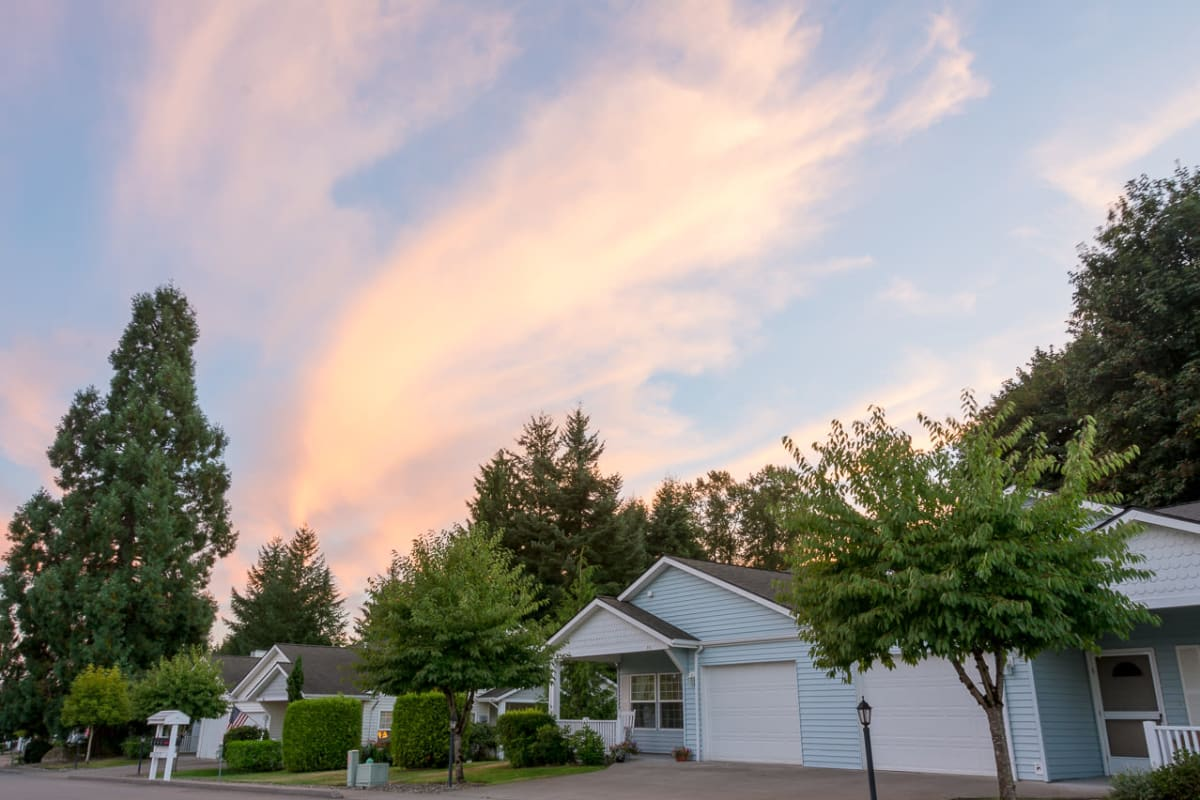 Independent living homes with a beautiful sunset in the background at Ashley Pointe in Lake Stevens, Washington