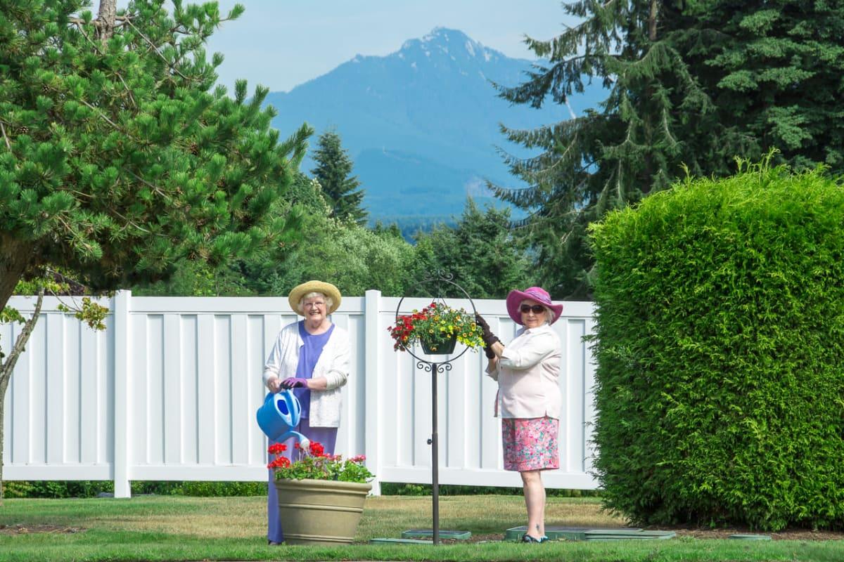 Residents gardening outside at Ashley Pointe in Lake Stevens, Washington