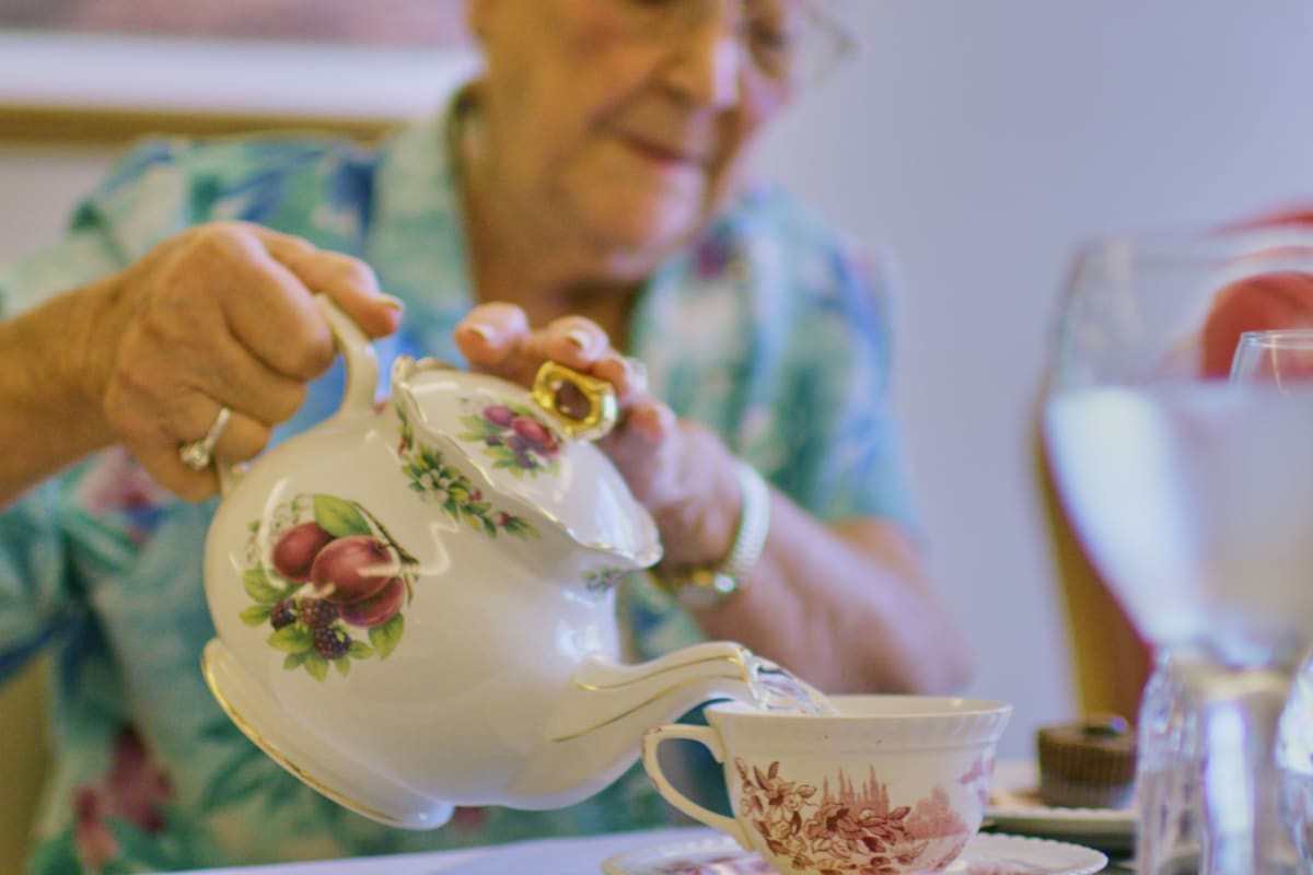 Resident pouring himself a glass of tea at Ashley Pointe in Lake Stevens, Washington