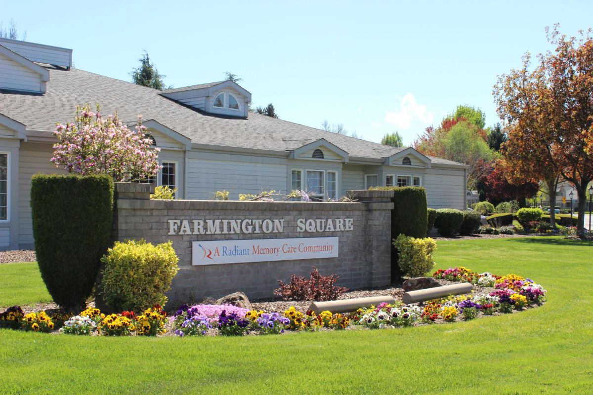 Signage on the lush lawn outside of Farmington Square Medford in Medford, Oregon
