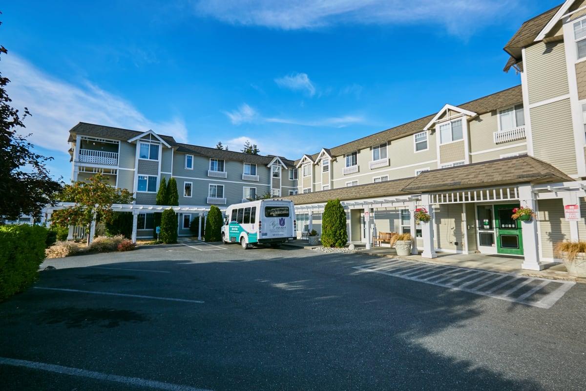 Community travel bus parked by a side entrance into La Conner Retirement Inn in La Conner, Washington