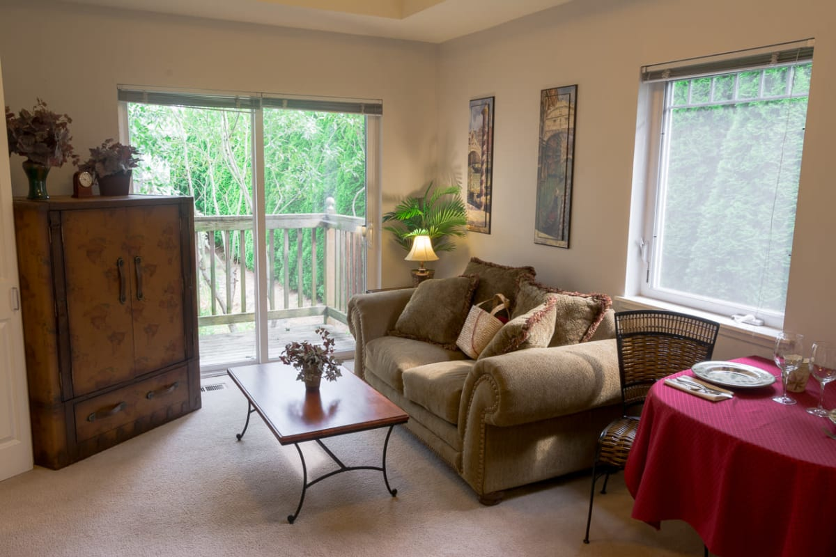 Furnished living room in a senior home at La Conner Retirement Inn in La Conner, Washington