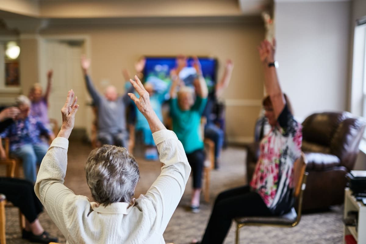 Residents engaged in group exercise at La Conner Retirement Inn in La Conner, Washington