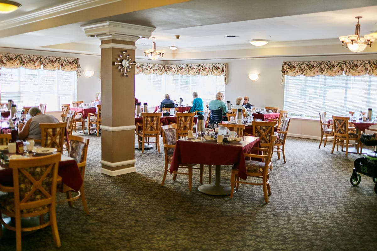 Group of residents having lunch in the dining hall at La Conner Retirement Inn in La Conner, Washington