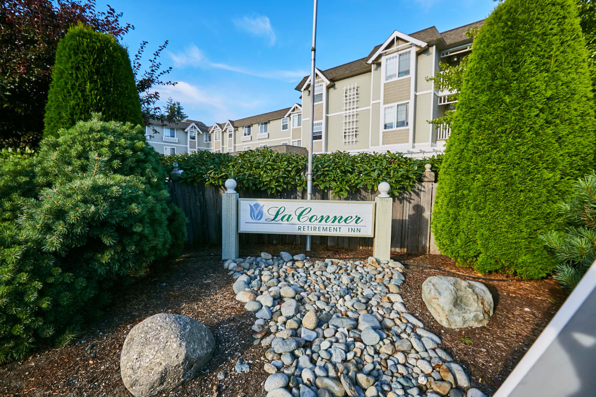 Signage over a small stone garden at La Conner Retirement Inn in La Conner, Washington