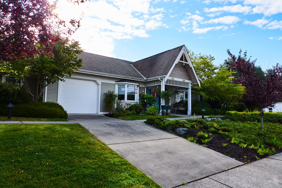 Cottage resident with a sloped driveway and garage at La Conner Retirement Inn in La Conner, Washington