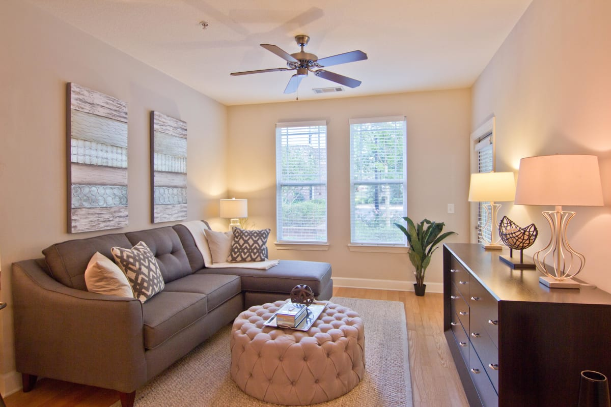 Ceiling fan and large windows in a model apartment's living area at Atlas Lavista Hills in Atlanta, Georgia