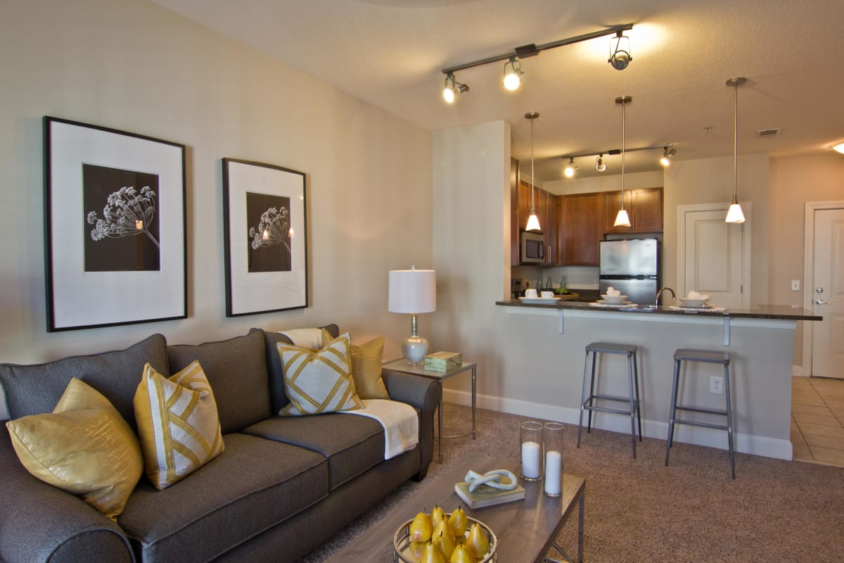 Modern decor and plush carpeting in a model home's living area at Atlas Lavista Hills in Atlanta, Georgia
