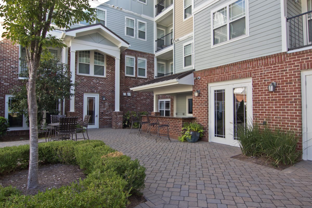Serene brick-covered patio at one of the exterior common areas at Atlas Lavista Hills in Atlanta, Georgia