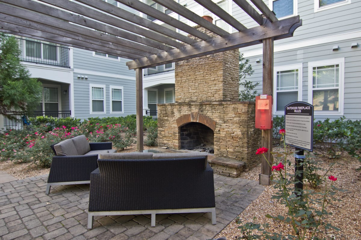Outdoor fireplace with lounge seating under a pergola at Atlas Lavista Hills in Atlanta, Georgia