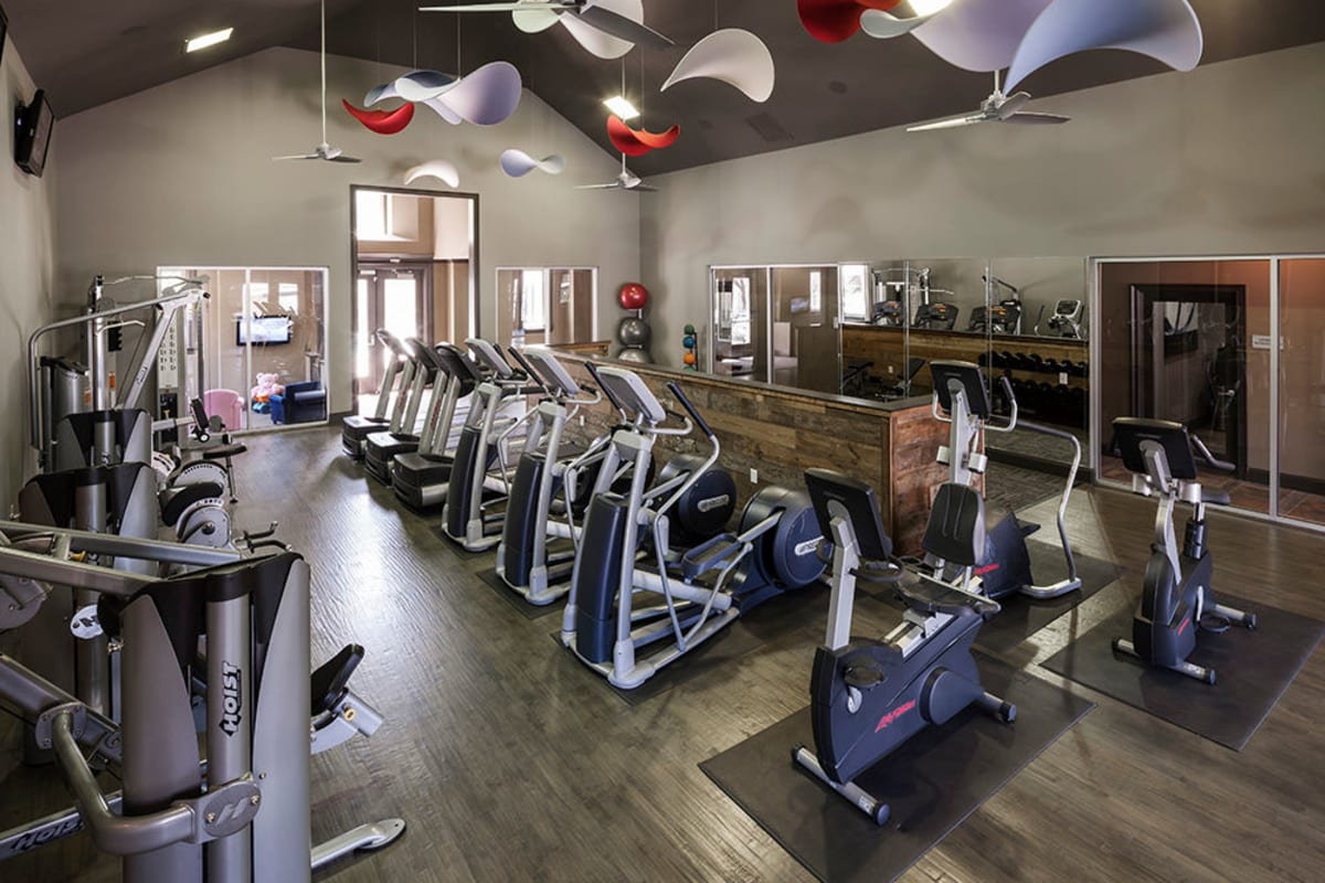Well-equipped onsite fitness center at Hyde Park at Montfort in Dallas, Texas