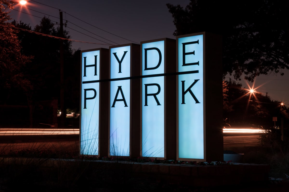 Our sign illuminated in the early evening welcoming residents home to Hyde Park at Montfort in Dallas, Texas