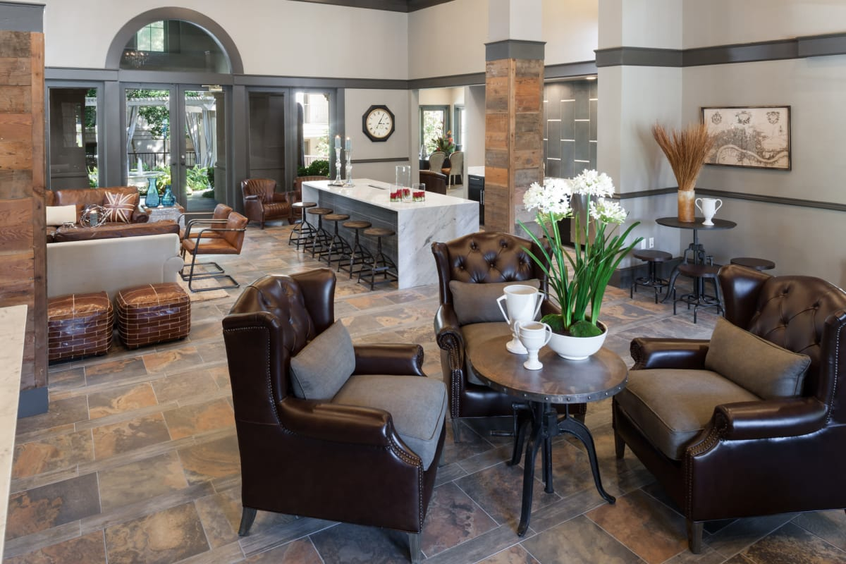 Warm and welcoming lobby with lounge areas at Hyde Park at Montfort in Dallas, Texas