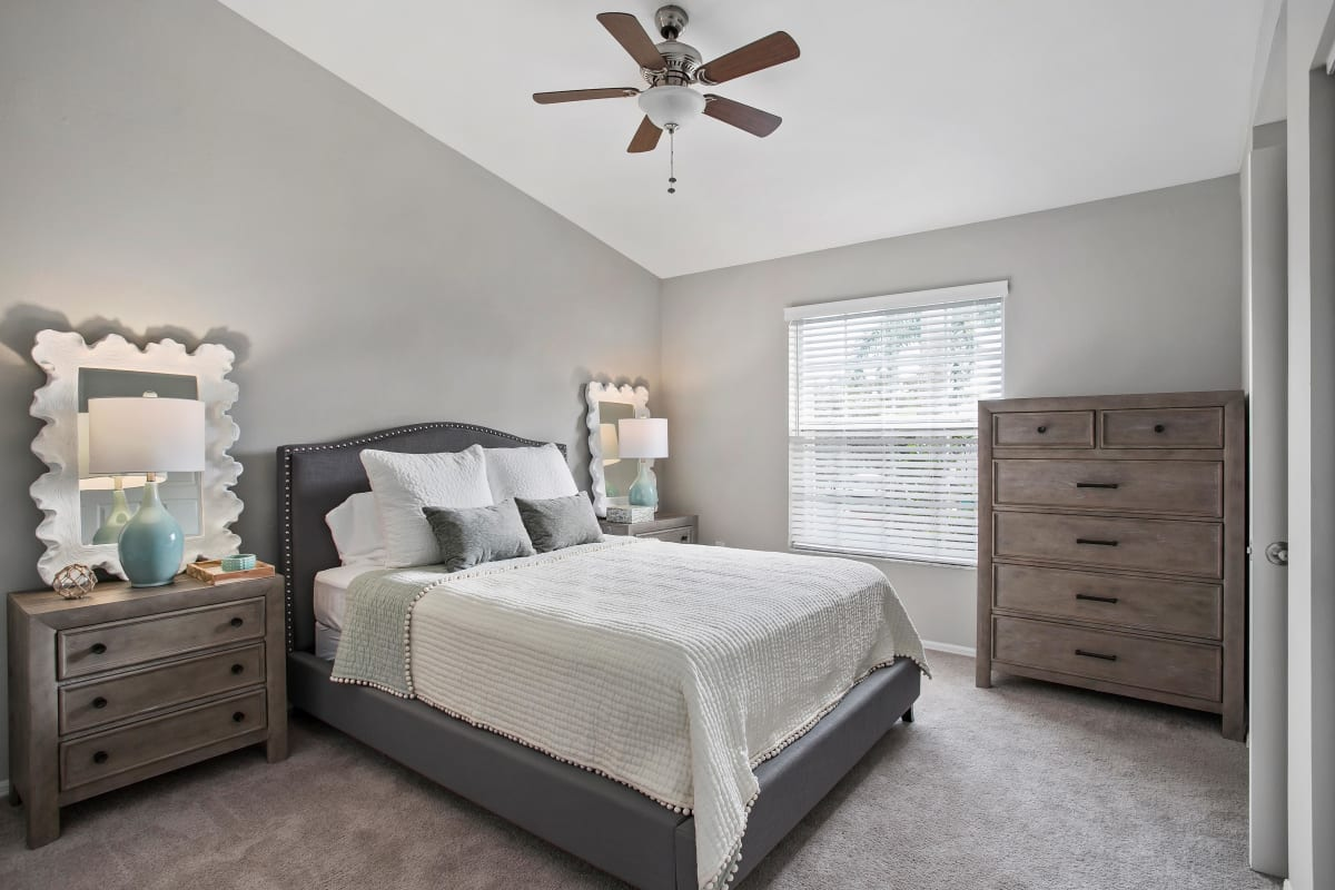 Ceiling fan and plush carpeting in a model home's bedroom at The Coast of Naples Florida in Naples, Florida