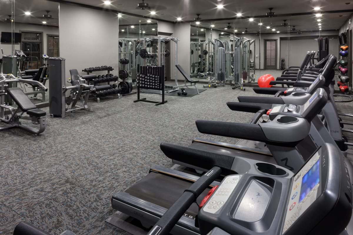 Well-equipped onsite fitness center with ample cardio equipment at Tintara at Canyon Creek in Austin, Texas