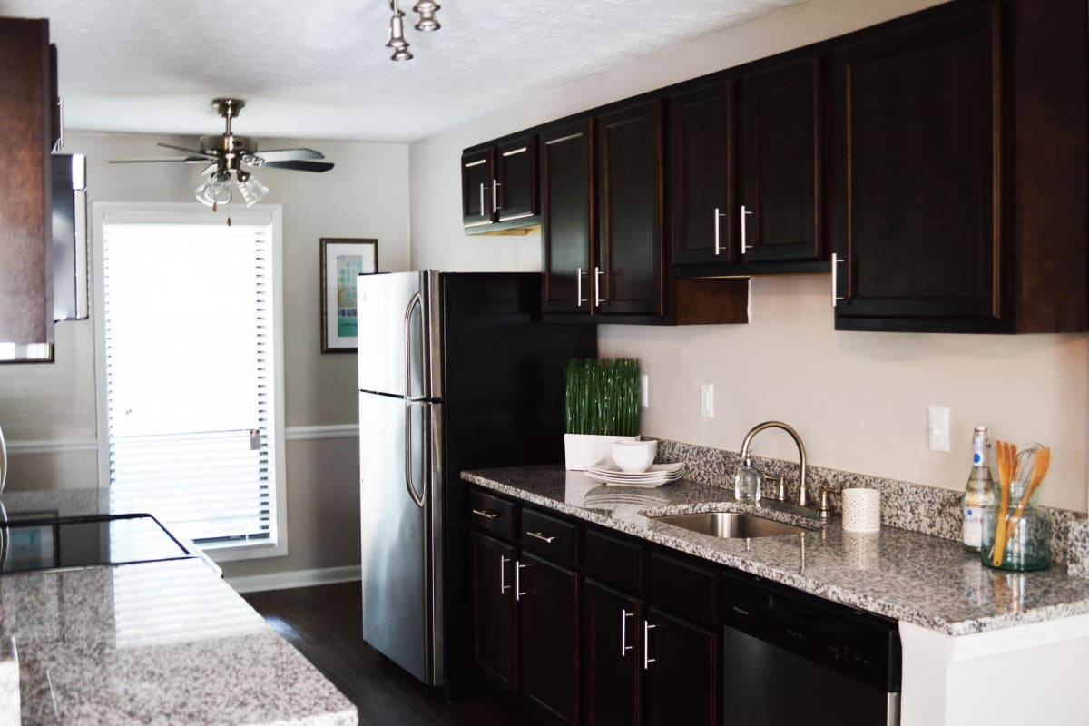 Granite countertops and stainless-steel appliances in a model apartment's kitchen at Park at Vinings in Smyrna, Georgia
