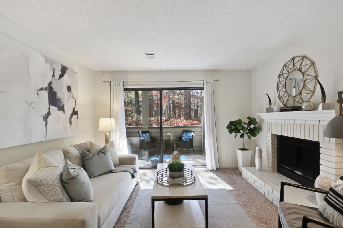 Modern furnishings and a fireplace in a model home's living area at Reserve at Peachtree Corners in Norcross, Georgia