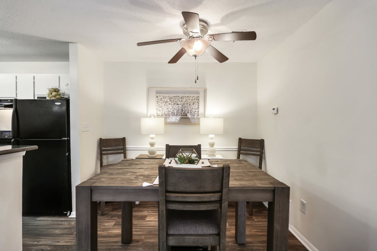 Ceiling fan over the dining area next to the kitchen of a model home at Reserve at Peachtree Corners in Norcross, Georgia