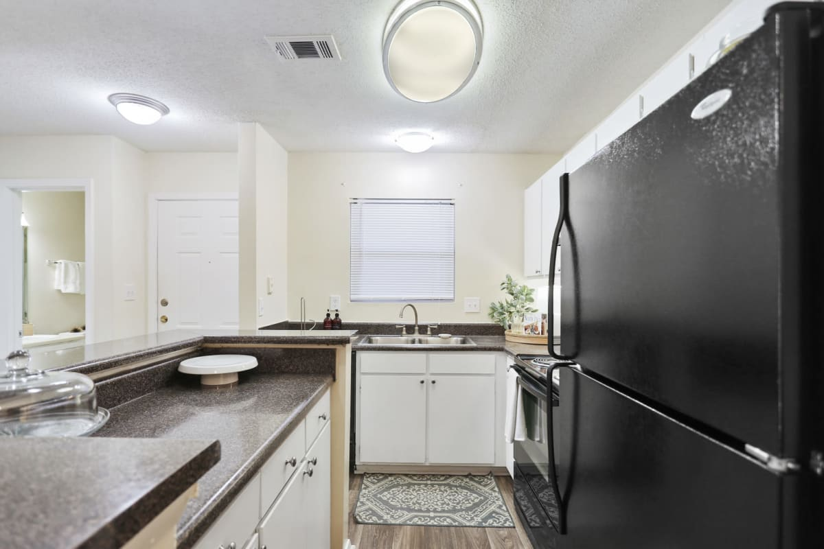 Black appliances and granite countertops in a model home's kitchen at Reserve at Peachtree Corners in Norcross, Georgia