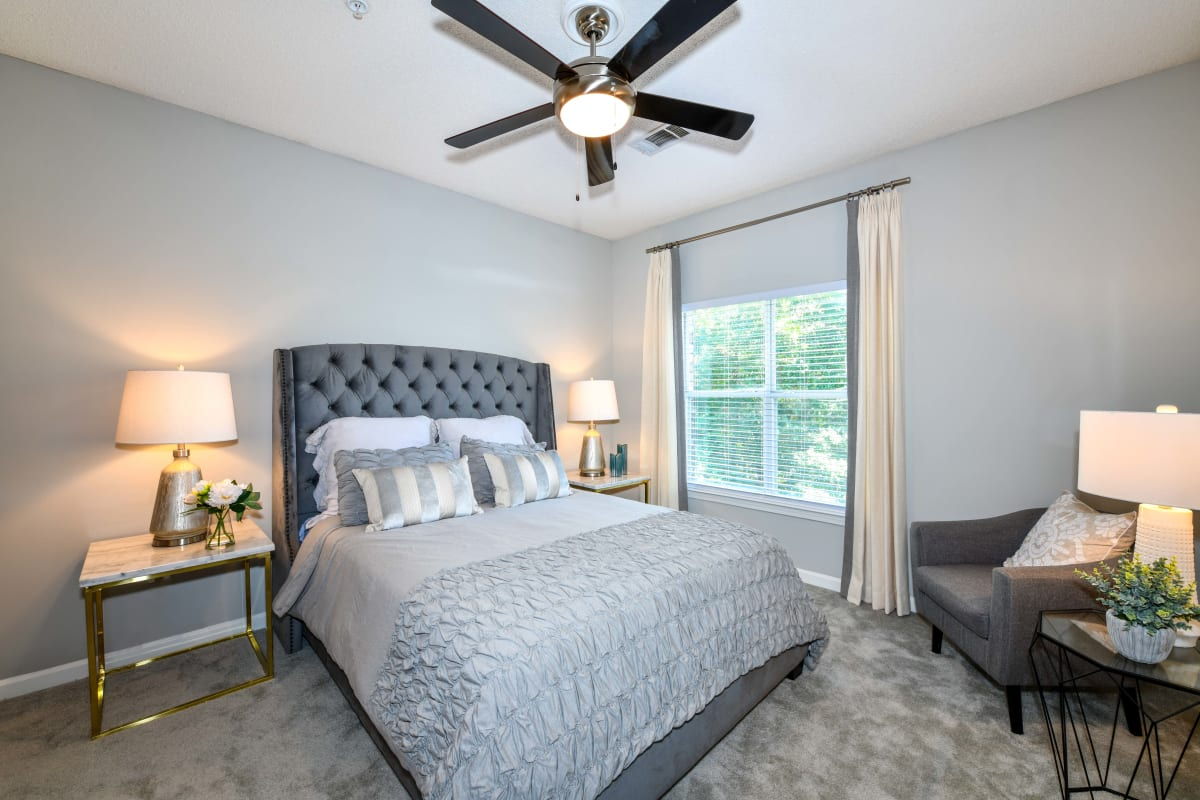 Plush carpeting and a ceiling fan in a model home's bedroom at 860 South in Stockbridge, Georgia