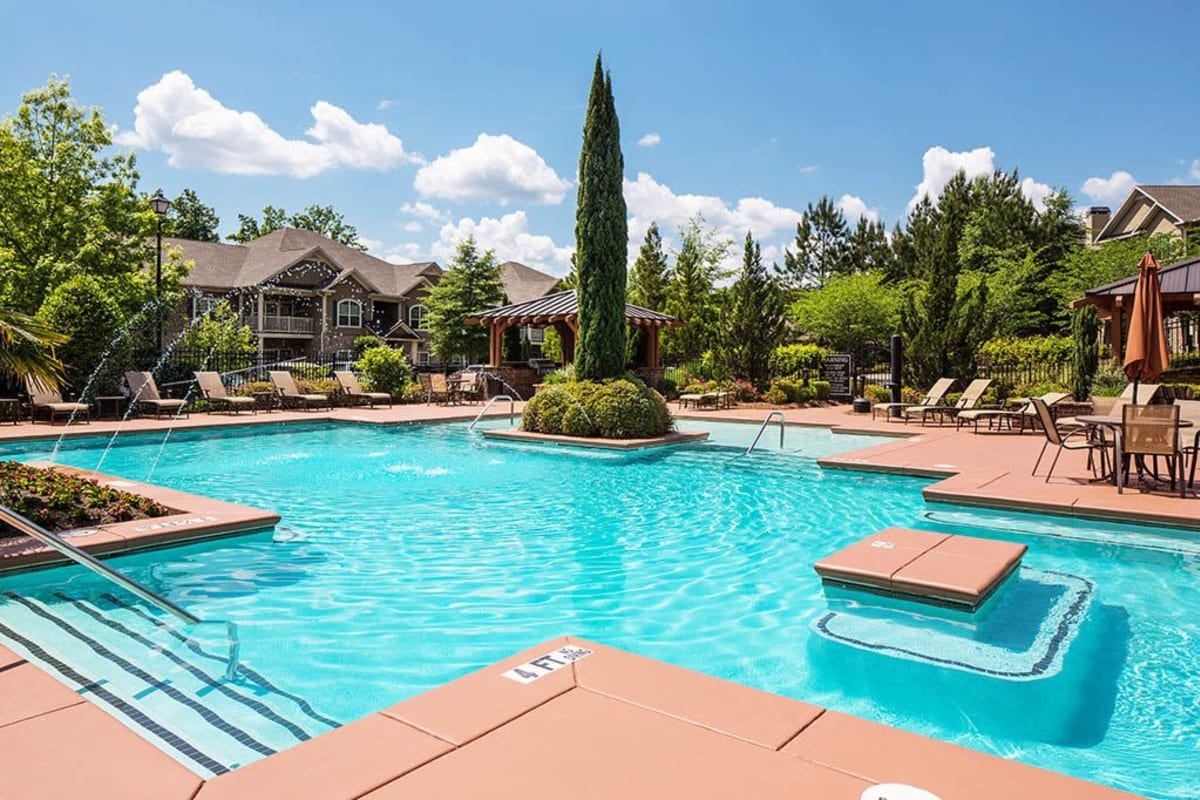 Resort-style swimming pool with an island and fountains at The Preserve at Greison Trail in Newnan, Georgia